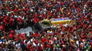 Thousands crowd the streets of Caracas as they mourn their president.